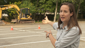 Sara Howie explaining rain garden construction