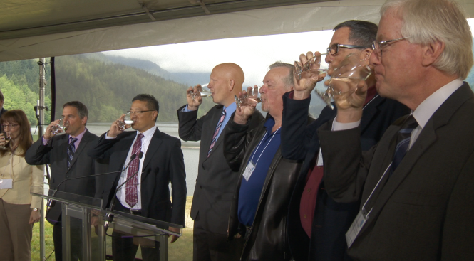 Metro Board directors and VIPs toast completion of the Twin Tunnels project.